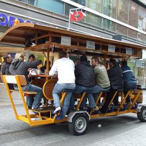 Stag mates having ride through the city on beer bike!